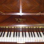 piano-droit-bord-en-palissandre