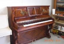 Piano droit de marque française BORD en palissandre d'exception